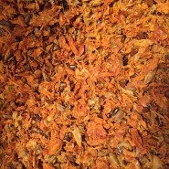 Frozen seabuckthorn pomace after juice production. Seeds and skins.